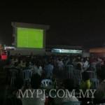 Football Fans Enjoying EPL Match