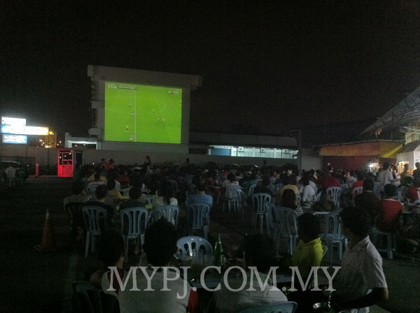 Football Fans Enjoying EPL Match